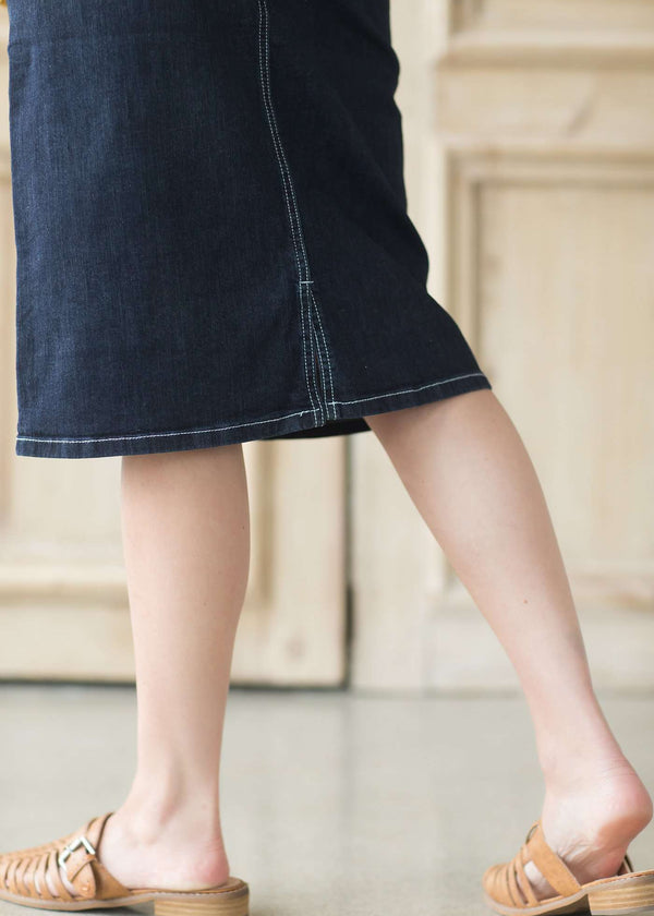 Pregnant woman wearing a modest midi jean maternity skirt