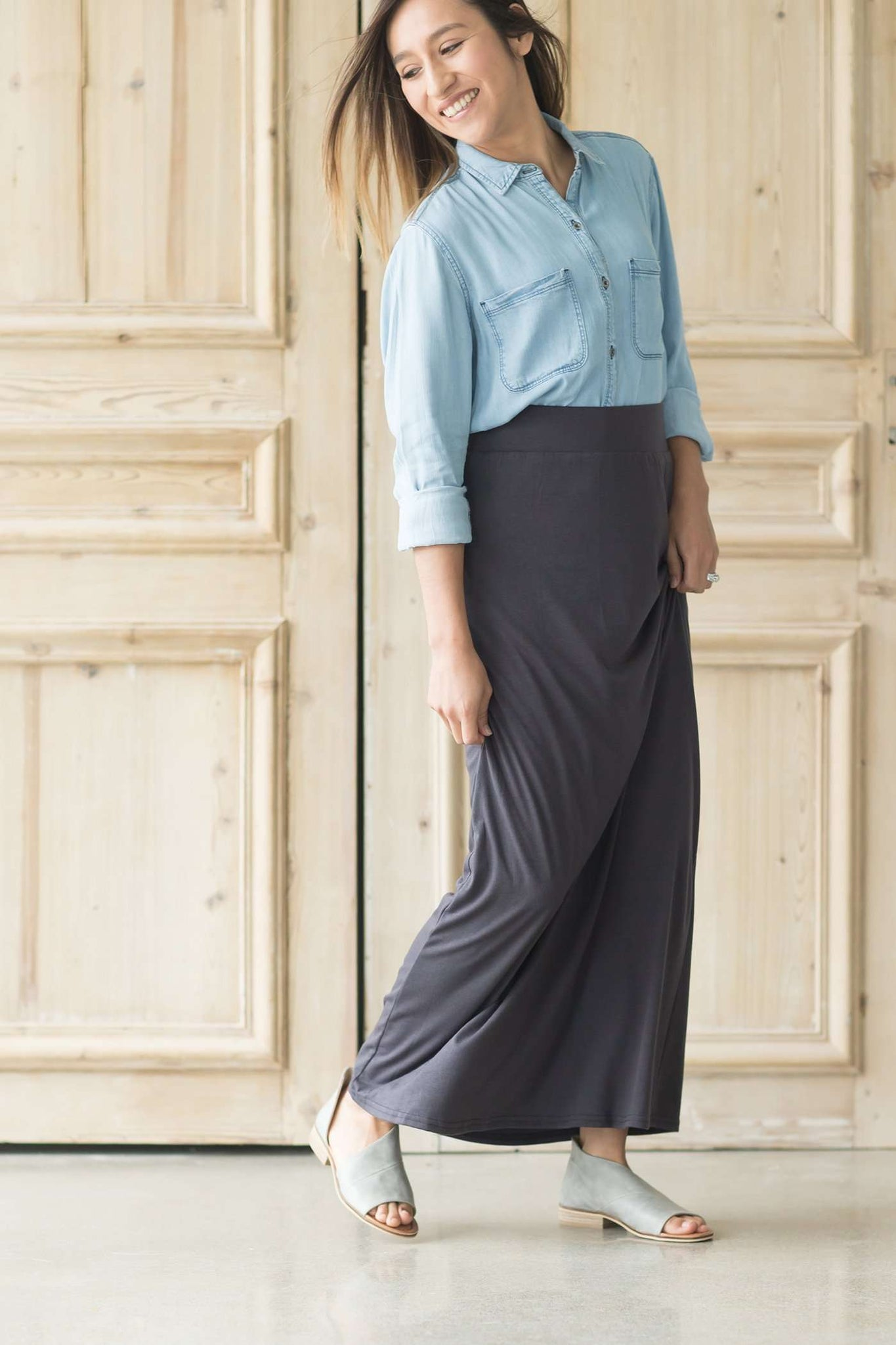 Women wearing a modest knit maxi dress in taupe, charcoal, navy, olive and black