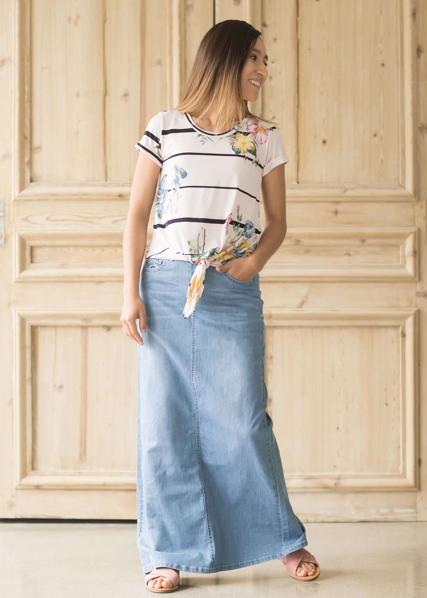 Long light denim maxi skirt with back slit and two pockets front and back.