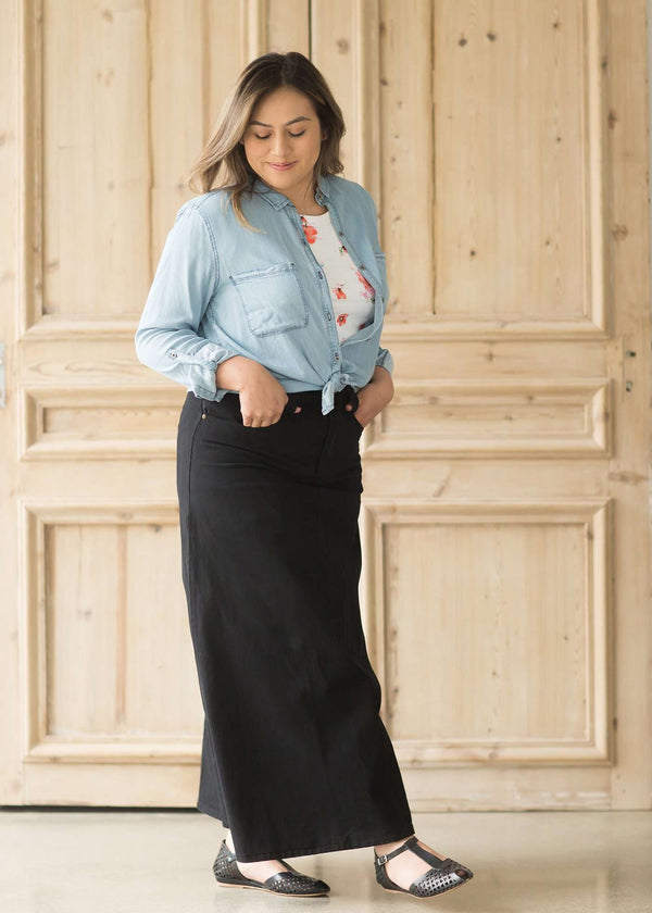 Inherit Co.  | Modest Plus Size Clothing | Classy Black Skirt | Woman wearing a classy, black maxi skirt with three button front closure.