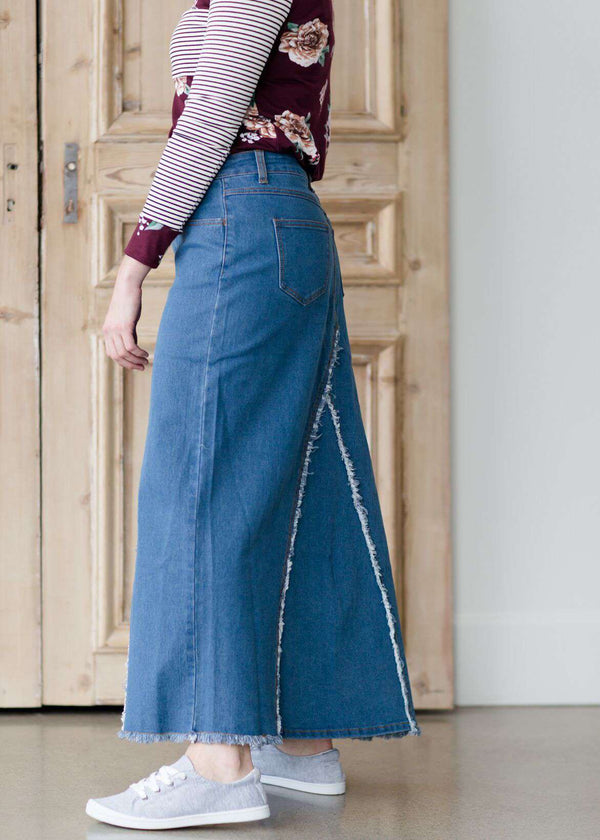 56cfe6083c woman wearing an a-line modest long denim skirt with fringe detail and no  slit