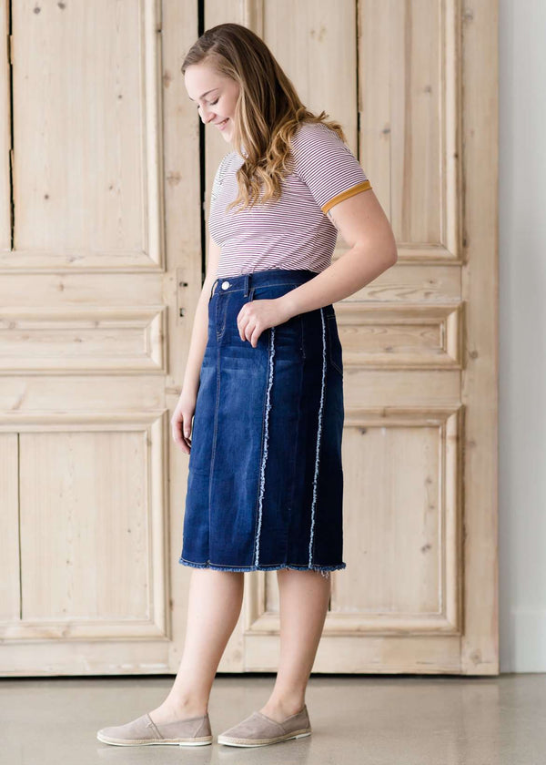 modest woman wearing a fringe dark denim below the knee skirt