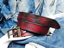 Wide red belt with black wash