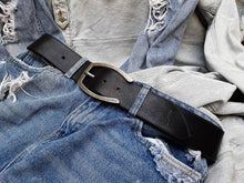Wide black belt with silver buckle