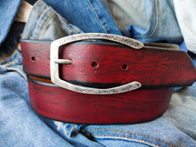 Wide red belt with black wash and silver buckle