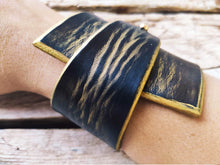 Wide black leather bracelet
