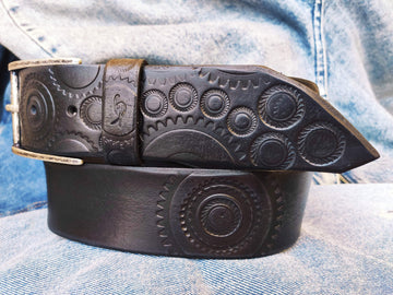 A handmade black leather belt embellished with stamps of motorcycle gear stunting belt for bikers the perfect gift for Motorcycle lovers