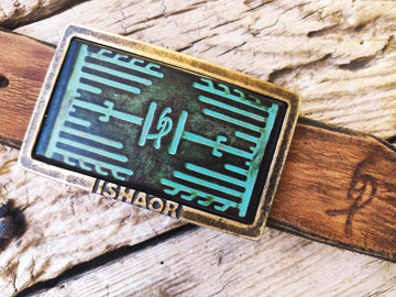 a Ishaor original square buckle with turquoise leather embossing with heat sink cooler & brown wash stunning buckle that upgrade any belt