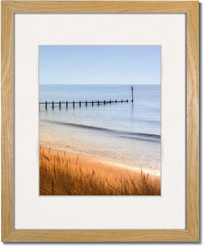 Coastal Wood Light Natural wood frames with single white mats.