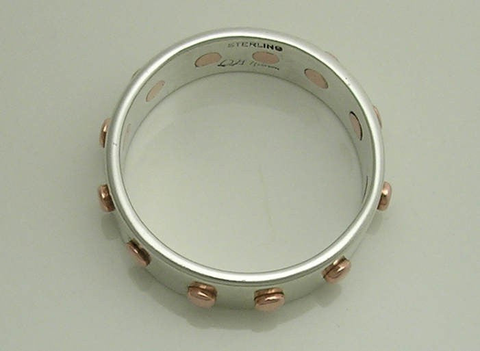 The 12 Rivet Ring