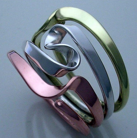 Niobium Energy Ring™. Blackened 4 Turn Vortex Size 5