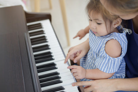 baby playing piano teething jewelry