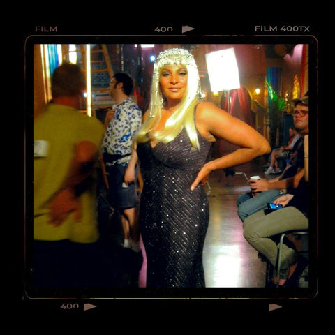 Film polaroid style photo of Pam Grier super glam look with platinum blond wig and fabulous sparkly cocktail dress