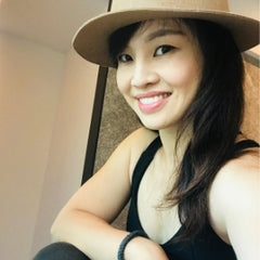 Heidi Chen wearing a felt hat smiling at the camera