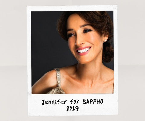 Jennifer Beals close up, smiling, wearing natural makeup look created using SAPPHO clean beauty products in 2019