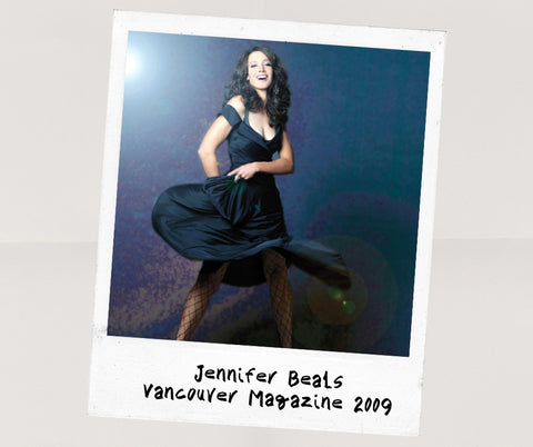 Polaroid of Jennifer Beals twirling a dark dress and laughing, shot for Vancouver Magazine in 2009 by Kharen Hill