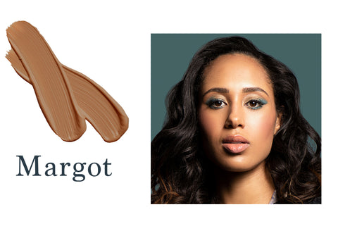 Dark skin model actress Margot Bingham wearing Margot foundation shade for Essential natural foundation with swatch on left