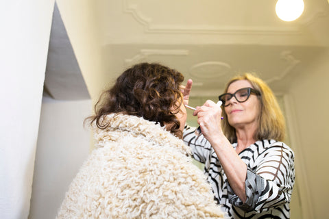 JoAnn Fowler founder of Sappho New Paradigm Cosmetics applying makeup