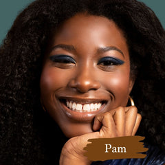 Dark skin model wearing Pam foundation shade for Essential natural foundation