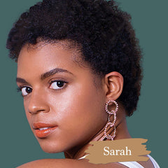 Best mineral foundation for natural makeup look on dark skin model with shade swatch and name