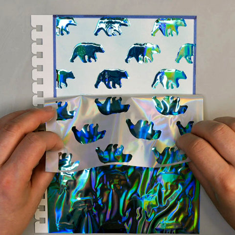 Removing Deco Foil Glass Slipper from Journal Page to reveal Wild Whisper Designs bear image