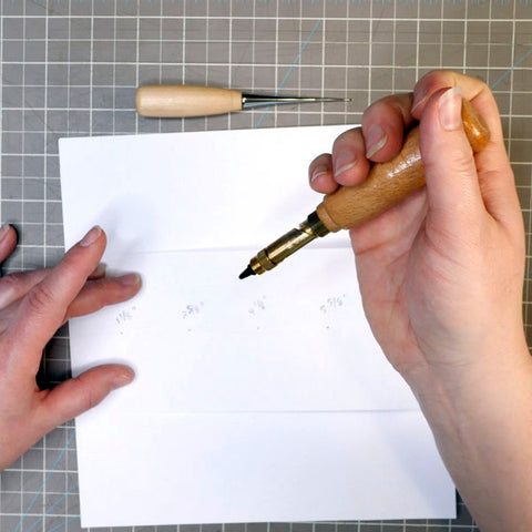Using a Screw Punch to Pierce Paper for Traveler's Notebook