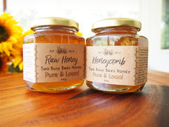 Raw honey and honeycomb in raw honey from Two Busy Bees Honey