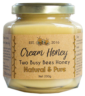Creamed-raw-honey-in-a-glass-jar-Two-Busy-Bees-Raw-Honey