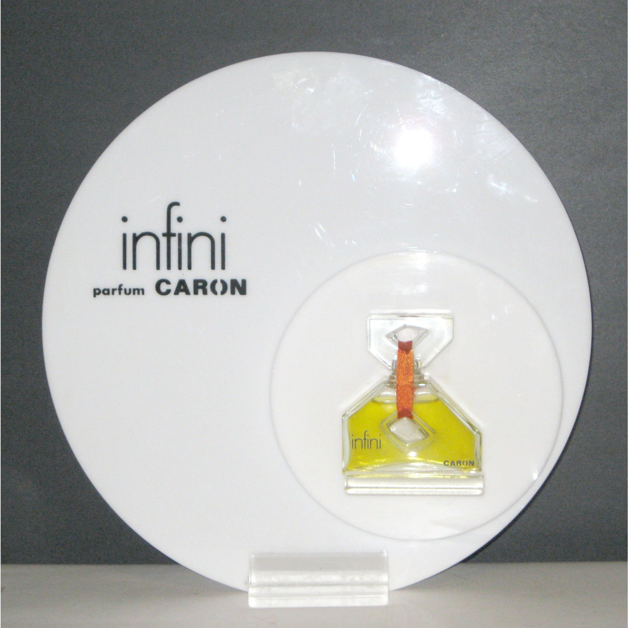 Vintage Infini Parfum Display By Caron