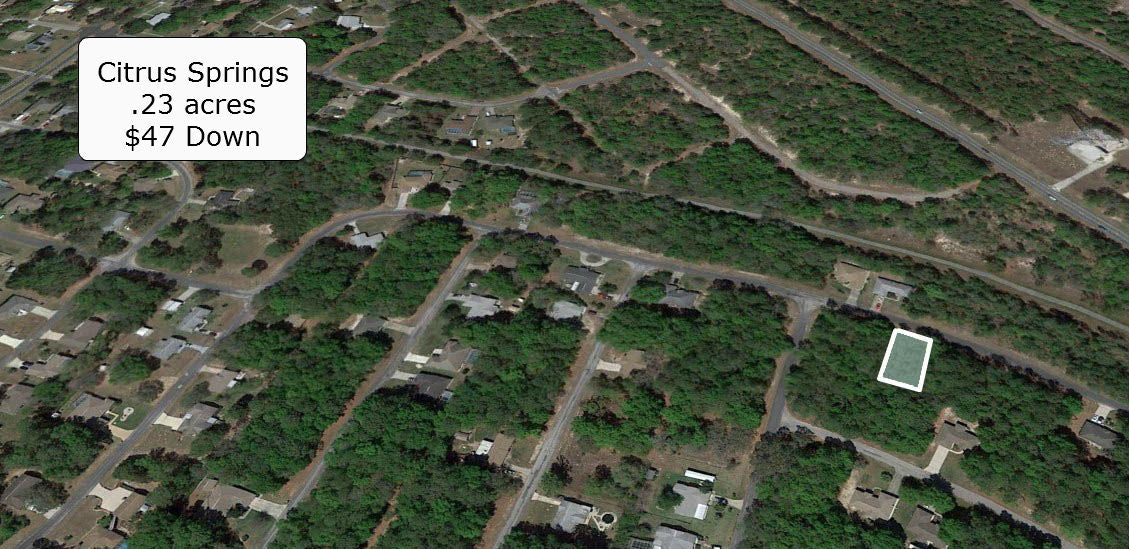 .23 acre lot on Paved Road-Planned - Close to US-41 Citrus Springs