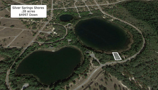 Waterfront .28 acre lot on Paved Road in Silver Springs Shores
