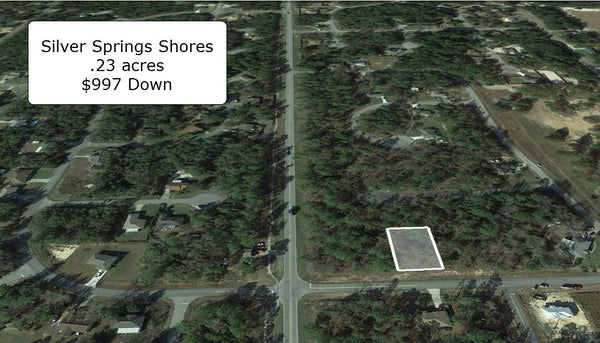 Exclusive .23 Acre Lot on Paved Road at Silver Spring Shores W-O/Finance