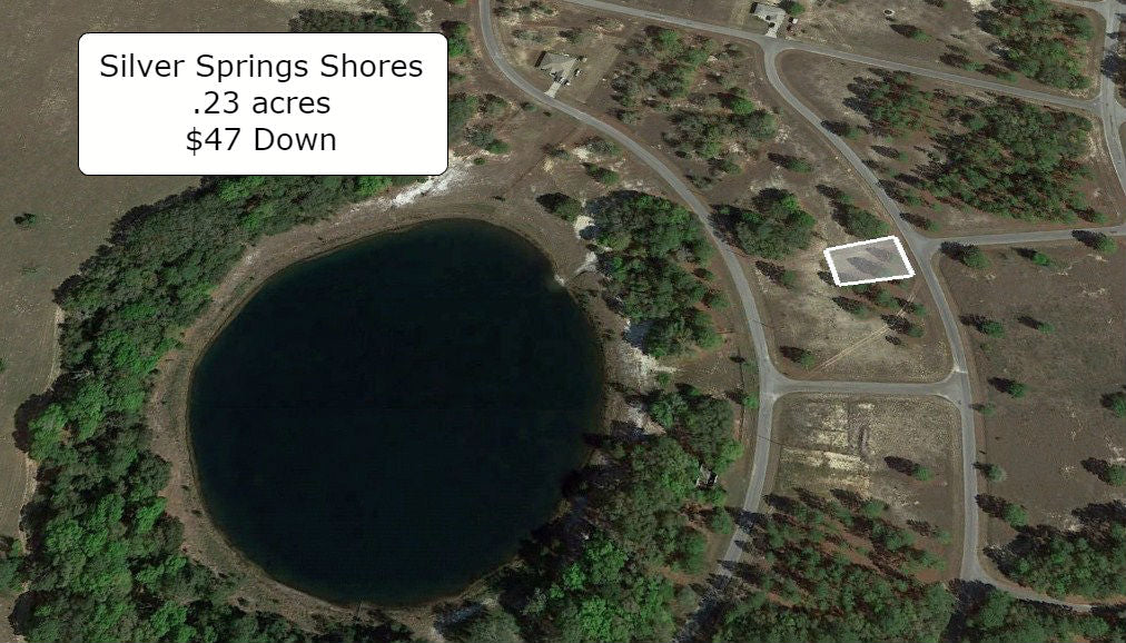 Exclusive .23 acre Cleared lot on Paved Road Surrounded by Lakes-O/Fin