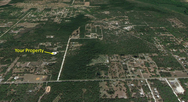 .23 acre lot with Owner financing- Great place to relax and get away!