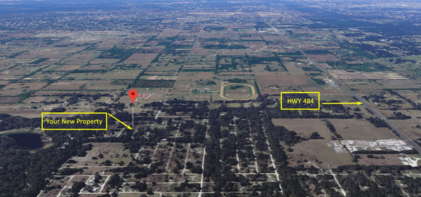Cleared .22 acre Property Minutes to HWY 484-Owner Financing Available