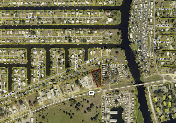 High Visibility Commercial .87 Acre Corner Lot on 441- Lake Okeechobee. Owner Finance Available
