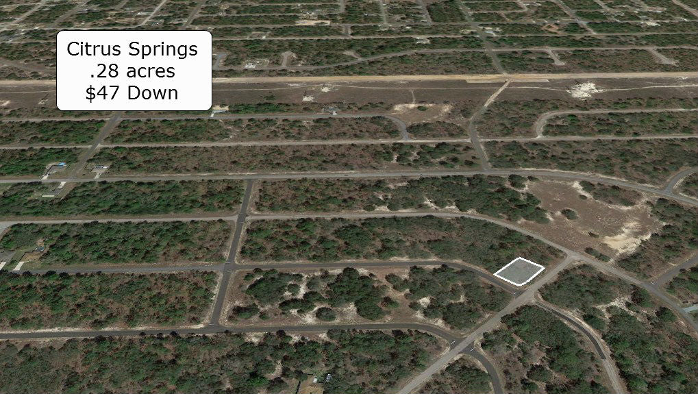 .28 acre Corner lot on Paved Road Minutes to Citrus Springs Golf Club