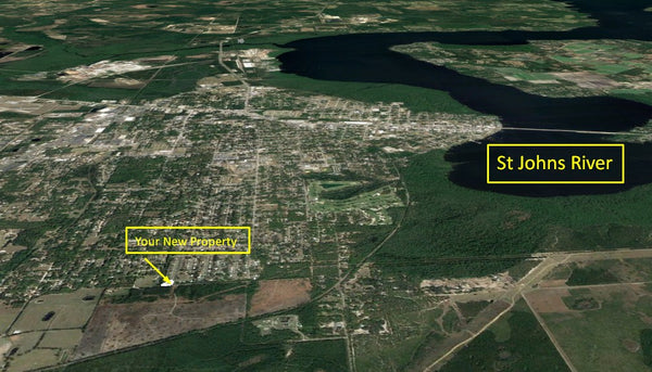 Exclusive .52 Acre Cleared Corner Lot on Paved Road- Min to St Johns River