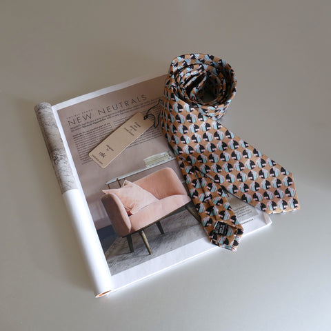 Sandy Eclipse Tie next to an Interior in Elle Dec