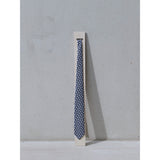 Eclipse silk Tie on a plinth