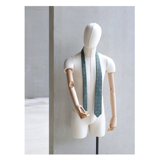 Fennel Tangle Tie designed by Niki Fulton. A green floral print. Seen here on a mannequin