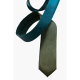 Moss silk tie designed by Niki Fulton. Blues and greens.