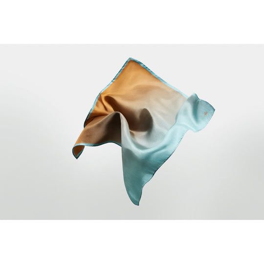 Salt silk pocket square designed by Niki Fulton. A blend of sandy camel to Hebridean sea blue
