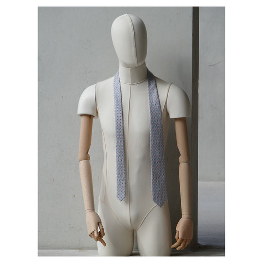 Lovewell Tie designed by Niki Fulton. A pale pink & duck egg blue graphical print. Seen here on a mannequin.