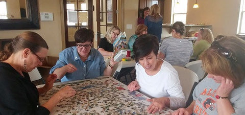 Women doing puzzles