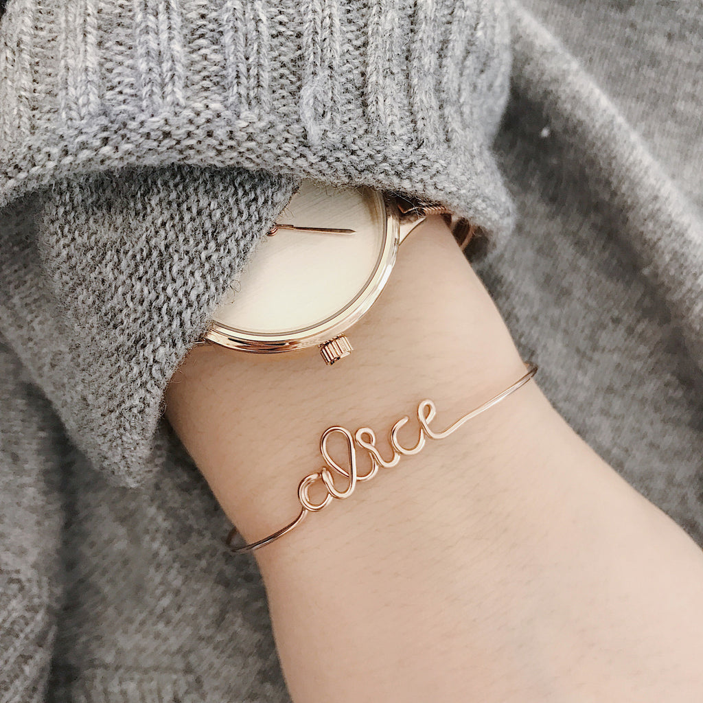 Personalised Alice name wire bangle bracelet in Rose Gold handmade by Rachel and Joseph jewellery UK