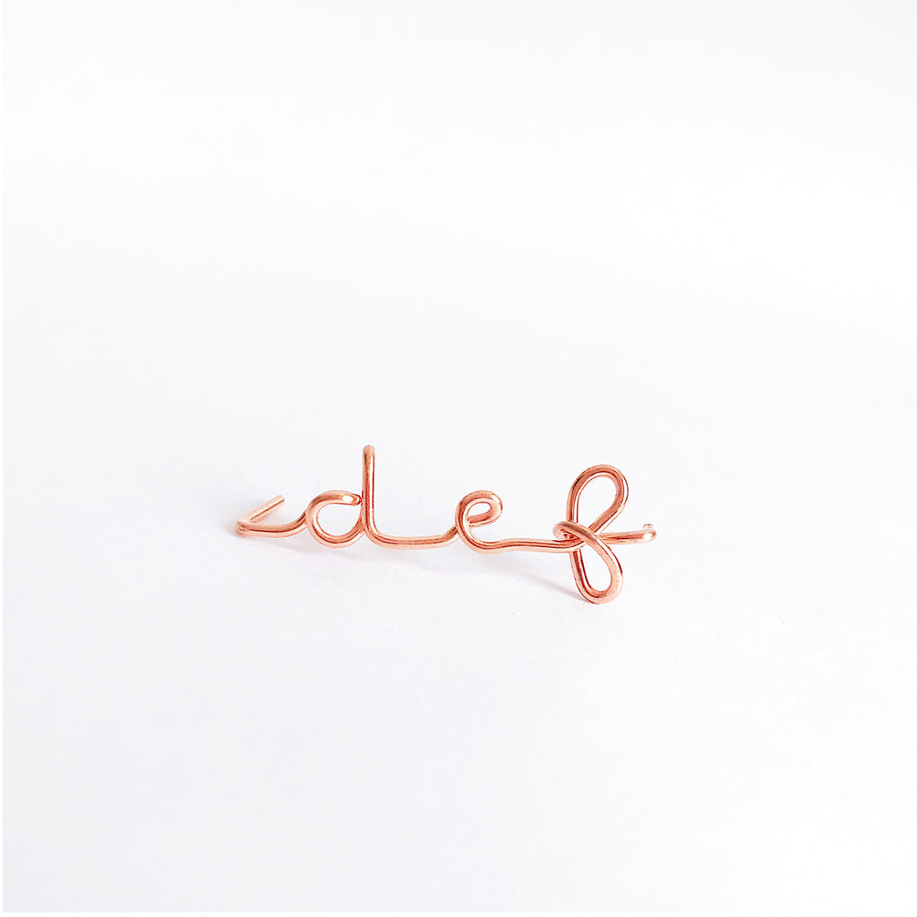 Personalised name initial def wire bangle bracelet in 14K Rose gold filled handmade by Rachel and Joseph Jewellery in London, UK wb