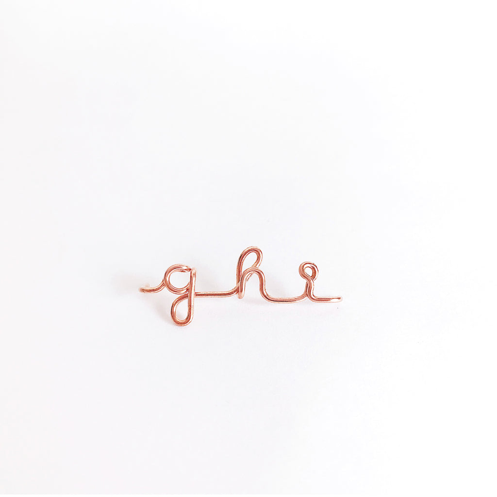 Personalised name initial ghi wire bangle bracelet in 14K Rose gold filled handmade by Rachel and Joseph Jewellery in London, UK wb