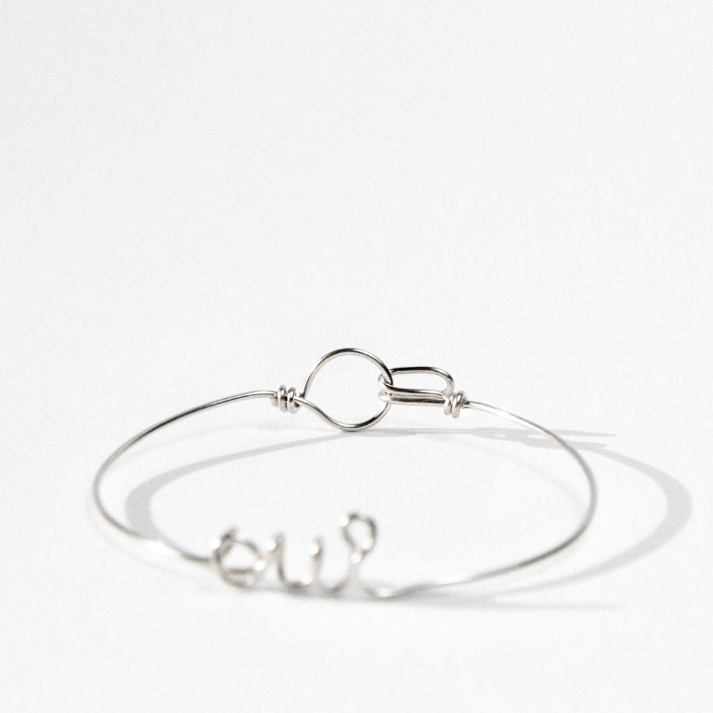 Personalised Oui name wire bangle bracelet in Argentium Silver handmade by Rachel and Joseph jewellery UK