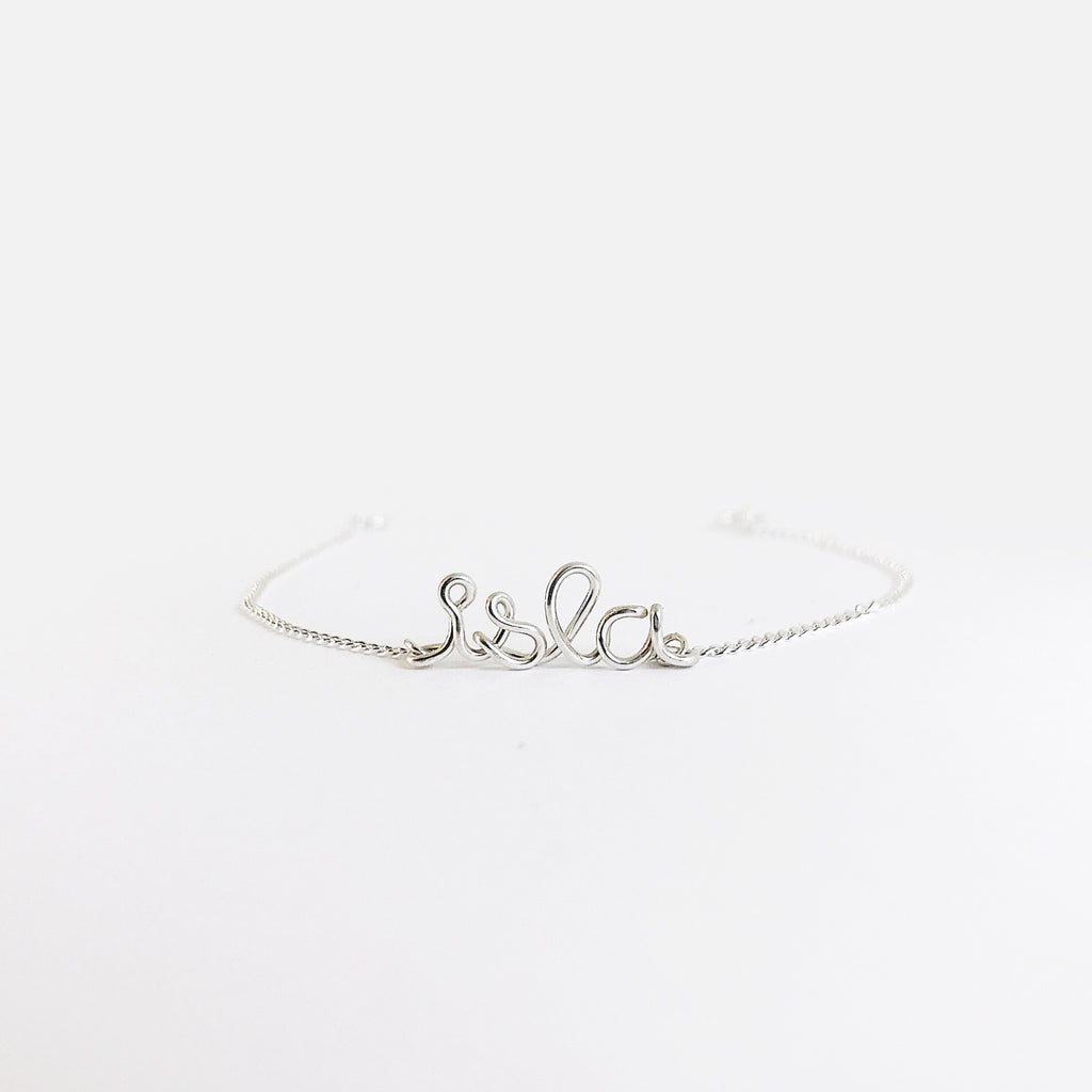 Details Personalised Isla name wire chain bracelet in Argentium® Silver handmade by Rachel and Joseph jewellery UK